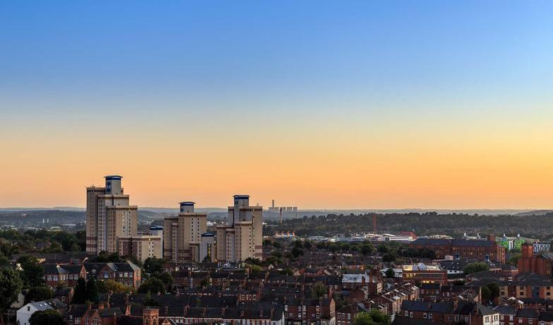 Radford flats tower block with power station behind in Nottingham