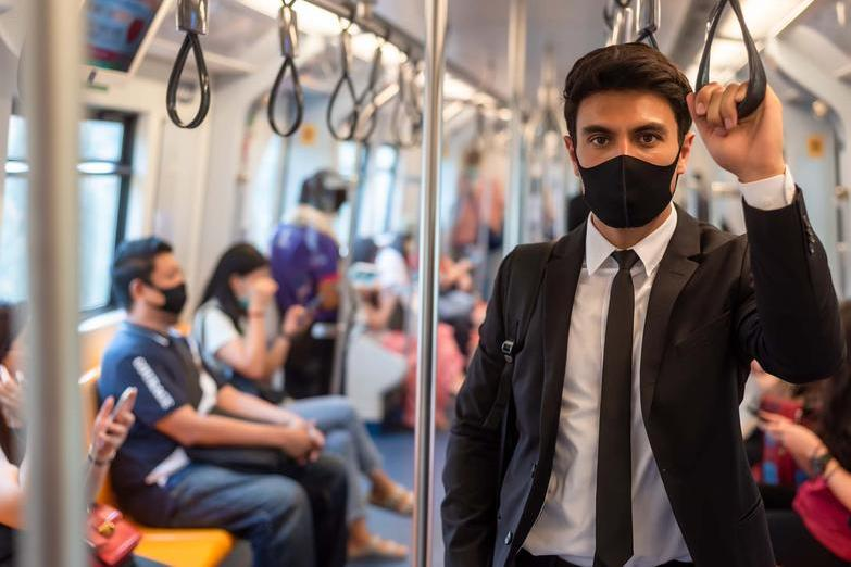 Travelling on train wearing face mask
