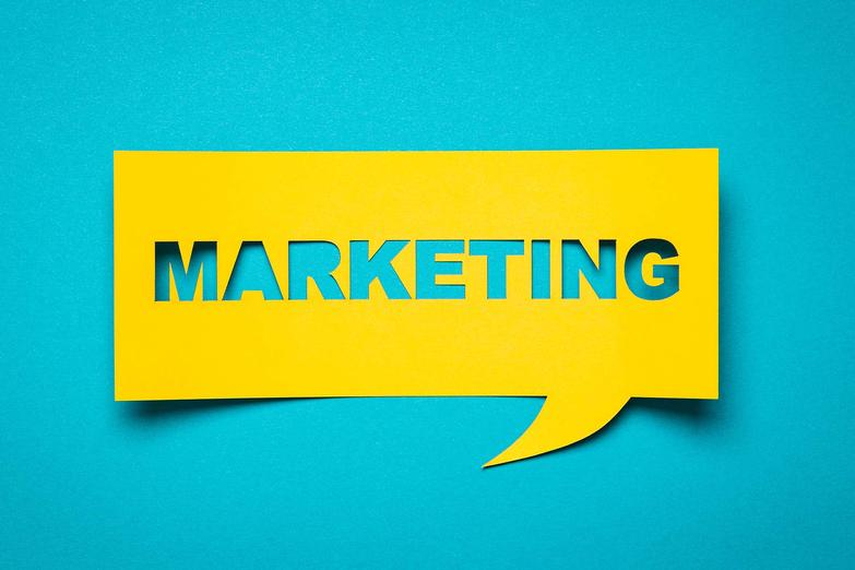 Marketing lettering cut out from brightly coloured paper